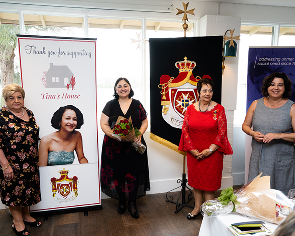 Four women from SHOSJ at fundraising event for Open Support
