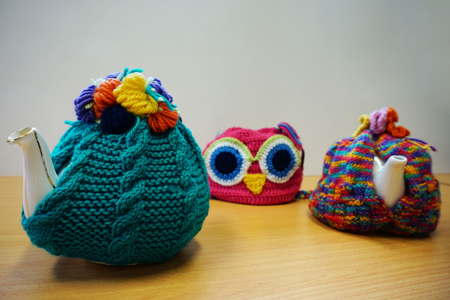 Assorted knitted tea-cosies to keep your tea warm