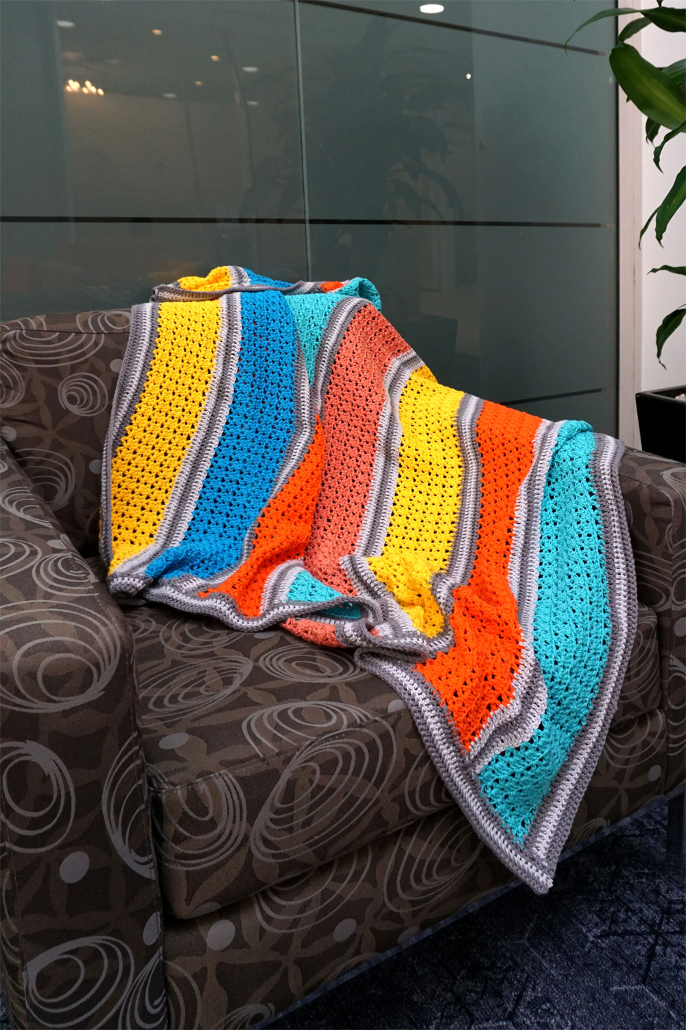 Bright and cheery crocheted throw